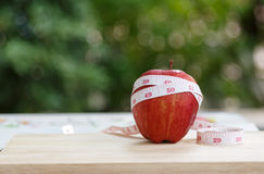 Red Apple fruit and measuring tape. Red Apple and measuring tape Stock Image