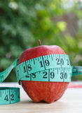 Red Apple fruit and measuring tape. Red Apple and measuring tape Royalty Free Stock Photo