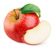 Red apple fruit with slice and green leaf isolated on white stock photo