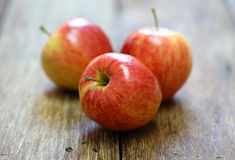 Red apple fruit on wood Stock Photos