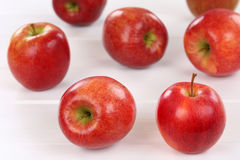 Red apple fruits on a wooden board Royalty Free Stock Photos