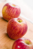 Red Apple Fruits on Wooden Table royalty free stock photos