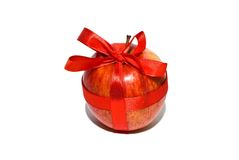 Red apple with a gift bow. On a white background Stock Photo