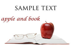 Red apple and glasses on the book Royalty Free Stock Photo