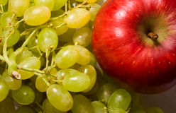 Red apple and grapes. Background of red apple and grapes Stock Images