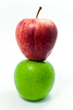 Red apple on green apple. ISOLATED Royalty Free Stock Photos