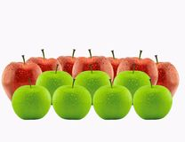 Red apple between green apples Royalty Free Stock Images