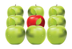 Red apple among green apples Royalty Free Stock Photo