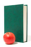 Red apple and green book Royalty Free Stock Photography