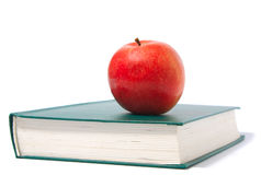 Red apple and green book Stock Images