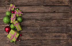 Red and apple green christmas presents with a checked ribbon on Royalty Free Stock Photo