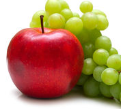 Red apple and green grapes Royalty Free Stock Images