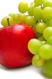 Red apple and green grapes Stock Photography