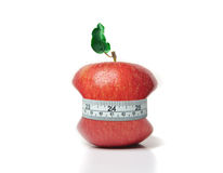 Red apple with green leaf and measuring tape Royalty Free Stock Image