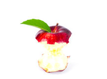 Red apple with green leaf and missing a bite . Royalty Free Stock Photography