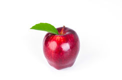 Red apple with green leaf on white background . Royalty Free Stock Photo