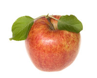 Red apple with green leafs Stock Photos