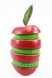Red apple and green measured tape Stock Photos