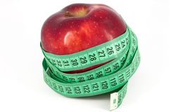 Red apple and meter Stock Photo