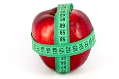 Red apple and meter Royalty Free Stock Image