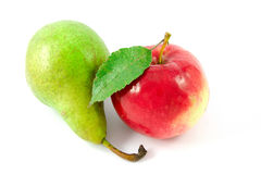 Red apple and green pear Stock Images