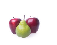 Red apple and green pear on a background. Stock Photos