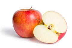 Red apple with half Royalty Free Stock Images