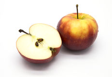 Red apple and half on white background Stock Images