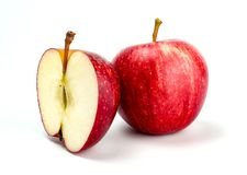 Red apple with apple half on white background stock photography