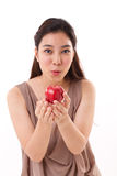 Red apple in hand of exited and healthy woman Stock Photography