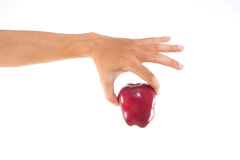 Red apple in the hand. Men hand holding the green apple Stock Image