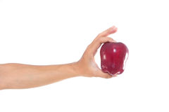 Red apple in the hand. Men hand holding the red apple on white isolate background Stock Images