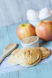 Red Apple Hand Pies and Raw Sugar and Eggs Royalty Free Stock Photography
