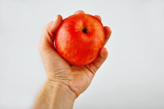 Red apple in a hand Royalty Free Stock Photos