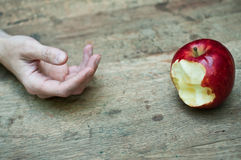 Red apple and hand  on wooden table background Stock Images