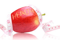 Red apple ,health text and measuring tape wrapped around. Stock Photography