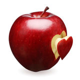 Red apple with heart. Red apple with a heart symbol against white background Royalty Free Stock Images