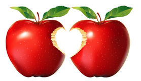 Red apple with heart bite Royalty Free Stock Images
