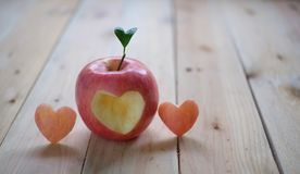 Red apple with a heart shaped cut-ou stock photo