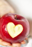 Red apple with a heart shaped cut-out Royalty Free Stock Photos