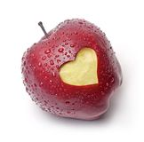 Red apple with a heart symbol. Fresh red apple with a heart symbol against white background Royalty Free Stock Photo