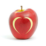 Red apple with a heart symbol Stock Photo