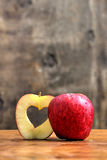 Red apple with heart symbol inside Stock Photos