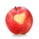 Red apple with heart on white background. 