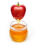 Red apple with honey Stock Photo