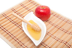 Red apple and honey Royalty Free Stock Image