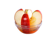 Red apple with honey Royalty Free Stock Photography