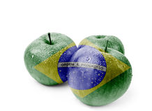 Red apple isolated with Brazil flag painted on.   Royalty Free Stock Images