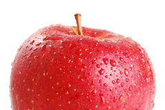 Red apple isolated on white. Ripe red apple isolated on white with visible drops of water Royalty Free Stock Photos