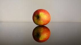 Red apple and its reflex Royalty Free Stock Photos